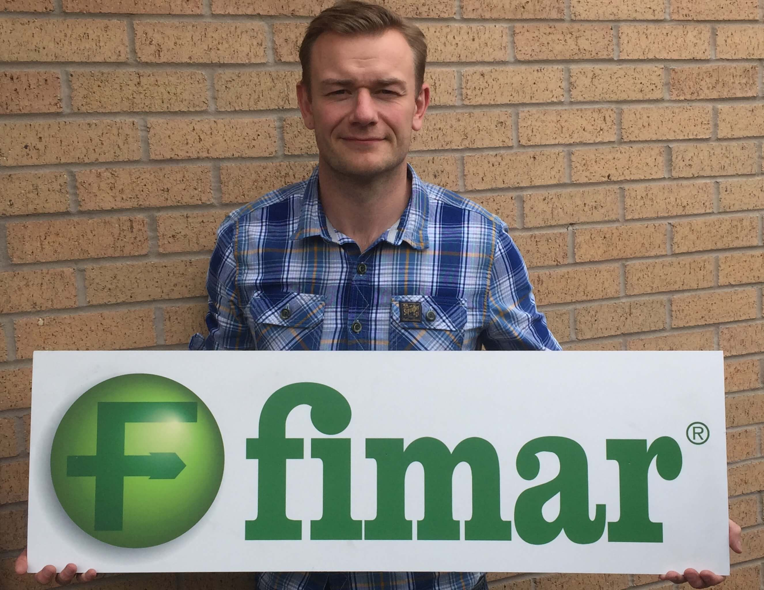 Cater-Bake Managing Director; Mark Hutchings holding Fimar logo